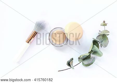 Concealer, Make-up Brush And Green Eucalyptus Branch On White Background. Top View, Flat Lay. Natura