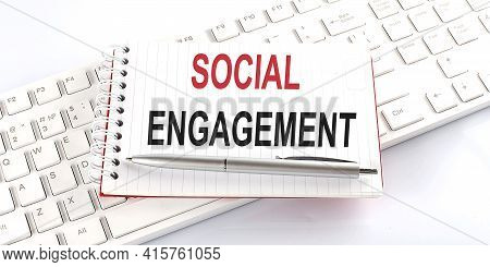 Text Social Engagement On The Keyboard On The White Background