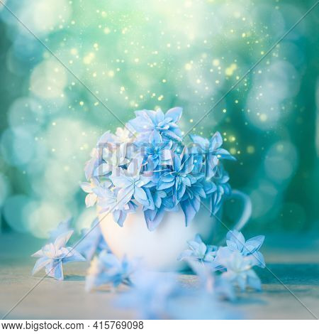 Delicate floral artistic background with blue flowers and bokeh. Conceptual romantic wallpaper design. Fragile blue flowers super macro