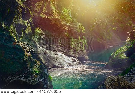 Emerald Forest River Flows Through The Rocks Covered With Moss. Forest Calm River Wild Water View. M