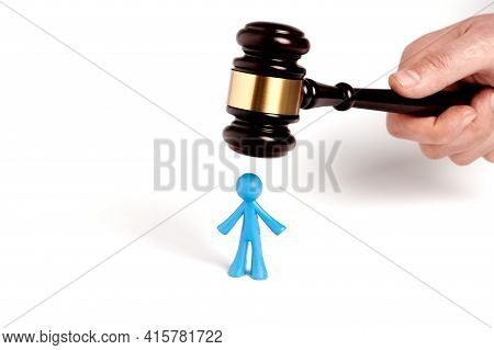 . Toy Man And Judge Gavel Isolated On White Background. The Concept Of Unfair Judgments. Antipopular