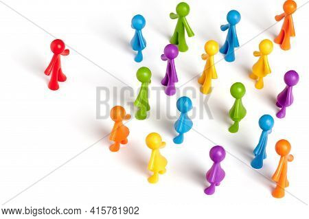 . Toy People Isolated On White Background. The Red Man Stands Apart From The Group. Asociality, Soci