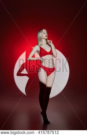 Young Fashion Woman In Red Lingerie Underwear Swimsuit Light And Shadow, Sensitive Woman Posing In A