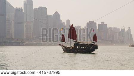 Tsim Sha Tsui, Hong Kong 12 February 2021: hong Kong victoria harbor with red Junk ship