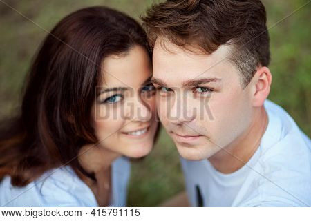 Portrait Of A Man And A Woman Huddled Together. Close Friends Posing For The Photographer Top View.