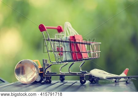Online Shopping, E-commerce Concept: Paper Shopping Bags In A Trolley Or Shopping Cart In The Natura