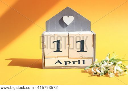 Calendar For April 11: Cubes With The Number 11, The Name Of The Month Of April In English, A Bouque