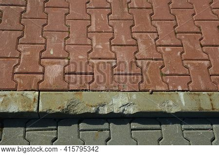 Heavy Containers Crush Concrete Interlocking Paving With Their Metal Wheels. It Is Necessary To Repa