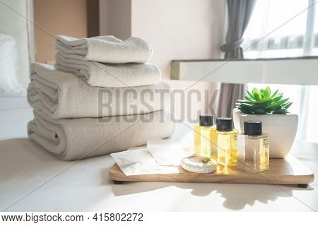 Set Of Hotel Amenities (such As Towels, Shampoo, Soap Etc) On The Bed. Hotel Amenities Is Something