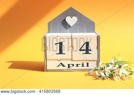 Calendar For April 14: Cubes With The Numbers 0 And 14, The Name Of The Month Of April In English, A