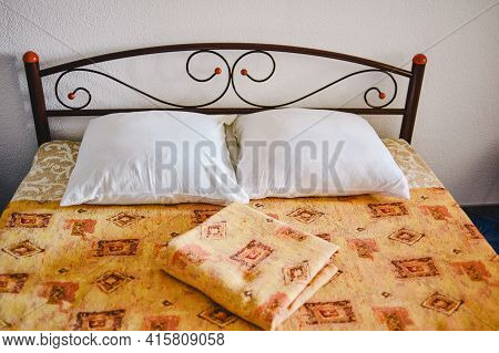 A Close-up Of A Made-up Bed In A Hotel Room. Made The Bed.
