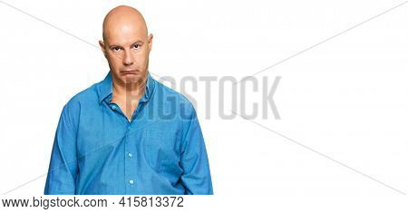 Middle age bald man wearing casual clothes depressed and worry for distress, crying angry and afraid. sad expression.