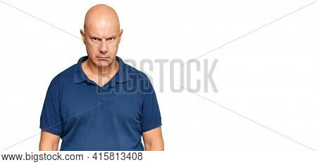 Middle age bald man wearing casual clothes skeptic and nervous, frowning upset because of problem. negative person.