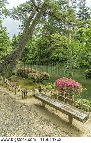 Wooden Seat In Idyllic Japanese Garden In Kanazawa, Japan