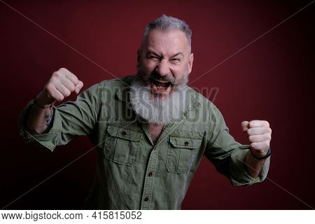 Mature Man With Fists Defense Gesture, Angry And Upset Man Over Red Background, Ready To Fight, Afra