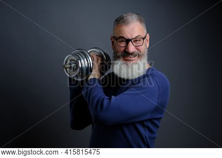 Bearded Mature Man With Dumbbell. Man With Dumbbell During Exercise. Sport, Workout, Fitness, Health