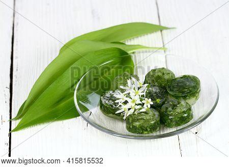 Frozen Wild Garlic, Lat. Allium Ursinum. Also Known As Bear Garlic Or Ramson On The White Rustic Woo