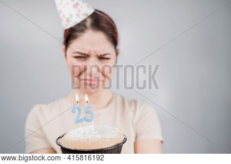 The Unhappy Woman Is Holding A Cake With Candles For Her 25th Birthday. The Girl Is Crying On Her An