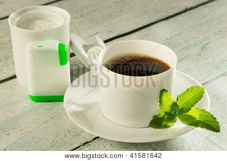 Cup of coffee with stevia sweetener tabs or in powder form