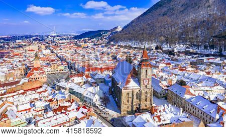 Brasov, Transylvania. Council Square And Black Church. Carpathian Mountains Travel Background In Rom