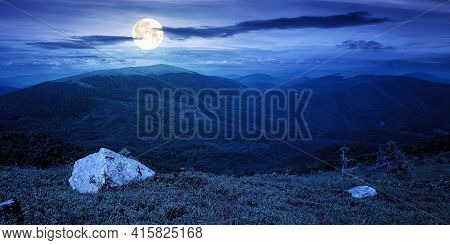 Carpathian Summer Mountain Landscape At Night. Beautiful Countryside With Rock On The Grassy Hill. V