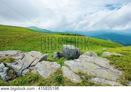 Alpine Mountain Scenery In Summer. Cloudy Weather. Stones And Boulders On Grassy Hills And Meadows.
