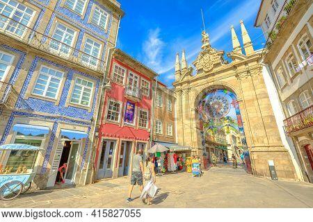 Braga, Portugal - August 12, 2017: People Walking Through The Arco Da Porta Nova, Looking East Along
