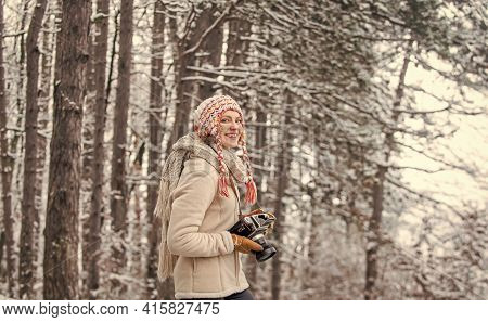 Winter Travel Vacation. Stylish Hipster Traveler. Woman Holding Photo Camera. Taking Picture In Wint