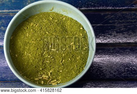 Canister With Yerba Mate On Blue Background. Yerba Mate Is A Medicinal Plant That Has A Thin Gray St