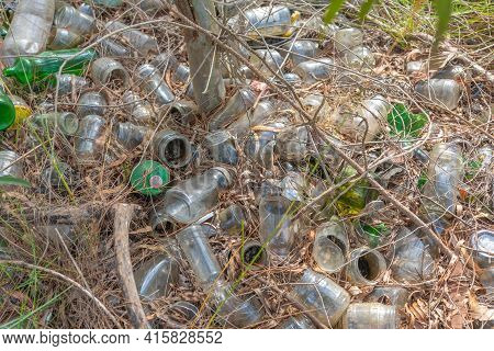 Irregular Disposal Of Glass Containers In The Environment. Environmental Disaster. Pollution. Dispos