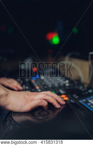The Djs Hand On The Mixer. Dj On The Turntables. Hand On A Mixer Close-up. Girl Man Dj At The Mixer