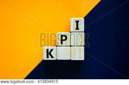 Kpi, Key Performance Indicator Symbol. Wood Cubes With Words 'kpi, Key Performance Indicator' On Ora