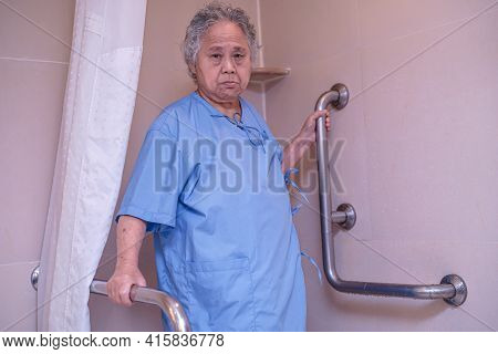 Asian Senior Or Elderly Old Lady Woman Patient Use Toilet Bathroom Handle Security In Nursing Hospit