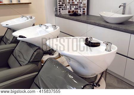 Barber Shop, Hairdressing Salon With Hair Wash Basins Chair Wiht Sink