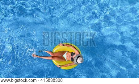 Beautiful Woman In Hat In Swimming Pool Aerial View From Above, Young Girl Relaxes And Has Fun On In