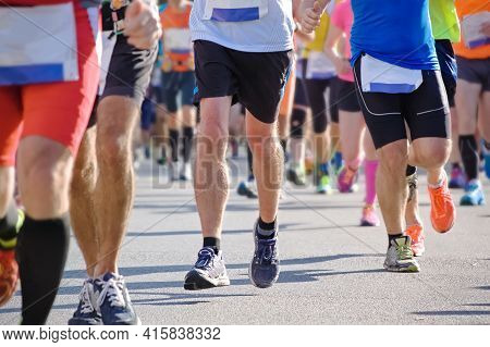 Marathon Running Race, Many Runners Feet On Road Racing, Sport Competition, Fitness And Healthy Life