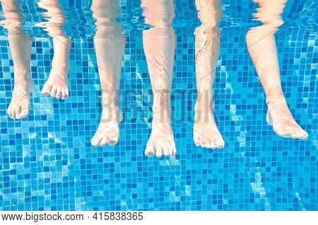 Family Legs Underwater In Swimming Pool, Swim With Children Under Water Funny Concept, Sport And Vac