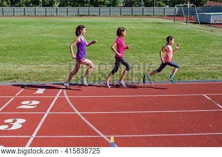 Family Fitness, Mother And Kids Running On Stadium Track, Exercise With Children  And Sport Healthy