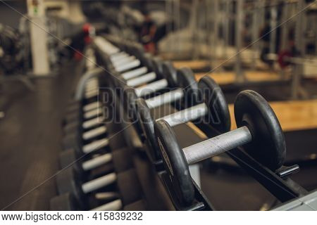 Fitness, Sport, Exercising, Weightlifting And Bodybuilding Concept - Close Up Of Dumbbells And Sport