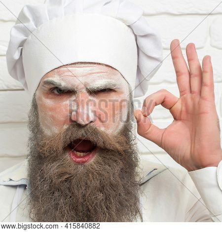 Man With Flour On Face Show Ok. Close Up Portrait Of Serious Baker Man, Cook With Flour On Face, Bea