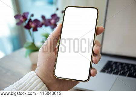 Man Hands Holding Golden Phone With Isolated Screen Over White Table In Office