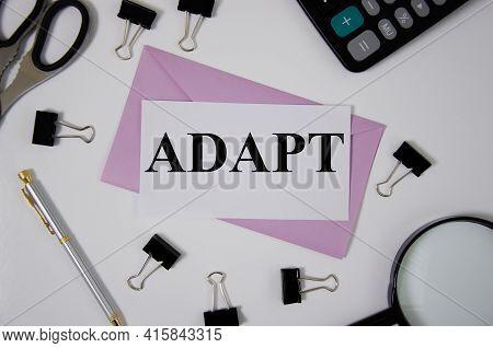 Adapt Word Written On Pink Envelope Near Office Supplies. Text