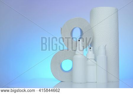 Hygiene And Sanitation . Toilet Paper, Napkins And Antibacterial In White Bottles On A Blue Blurred