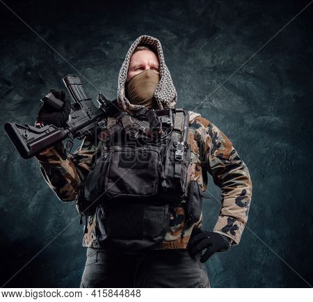 Brave And Proud Soldier Poses In Dark Background Holding A Rifle