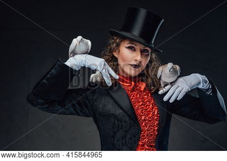 Professional Performer And Three Pigeons In Dark Background