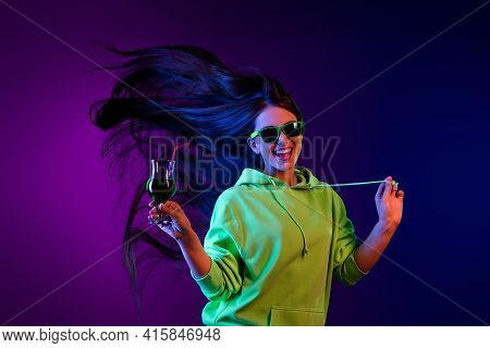 Photo Of Charming Happy Nice Young Woman Hold Cocktail Smile Party Isolated On Gradient Neon Backgro