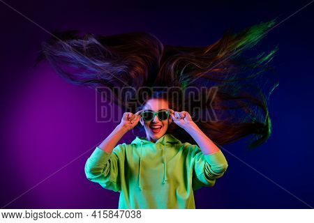 Photo Of Nice Cool Young Nice Woman Long Hair Blow Wind Clubber Good Mood Isolated On Neon Backgroun