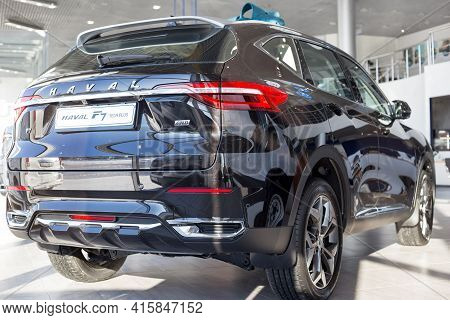 Russia, Izhevsk - February 17, 2021: Haval Showroom. New Modern F7 Tech Plus Car In Dealer Showroom.