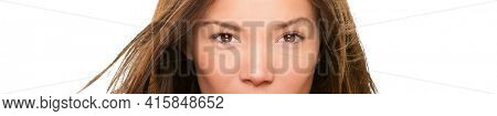 Asian eyes beauty woman face portrait. Piercing stare of ethnic multiracial model. Closeup of eyes, nose. Beautiful young Chinese Caucasian biracial girl isolated on white panoramic banner.