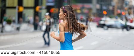 Running workout in city street - Woman athlete training outdoors jogging in NYC downtown for healthy active lifestyle. Panoramic banner background.